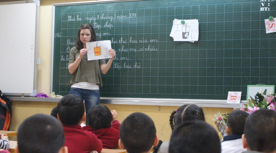 A volunteer runs an English class as a teacher in Vietnam
